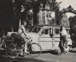 Outing Club Car with Three Students on Campus