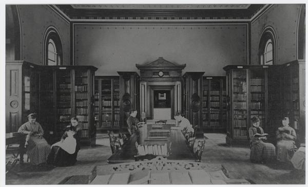 Six students study in the library, ca. 1876.