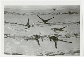 Six students performing synchronized swimming (water ballet)