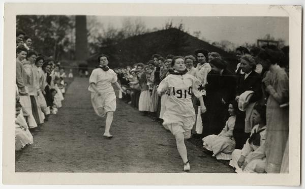 Students running in a track event