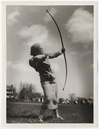 Dance teacher Marie Heghinian on the archery range, drawing her bow and arrow