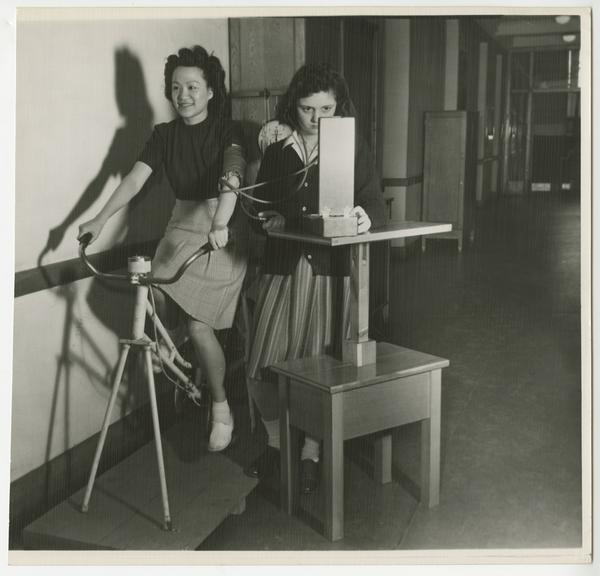 Virginia Fong (Class of 1946) and Joan Newcomb (Class of 1946) performing a physiology experiment
