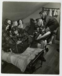 Outing Club members on a bicycle trip, bedding down overnight in the cabin