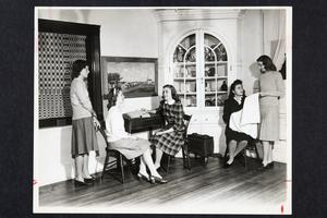 Five students in the Mary Lyon Room in Student Alumnae Hall (renamed Mary E. Woolley Hall in 1945)