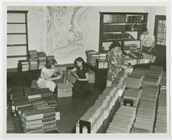 Students processing books at the Hampshire Inter-Library Center, l-r, Greta Gustafson '54, Nancy Rittmaster '54, Barbara Hubbard (GS), and John Bristol