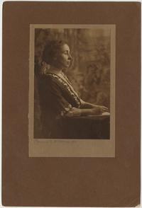 Jeannette Marks seated, profile view, studio portrait by Katherine McClellan, photographer