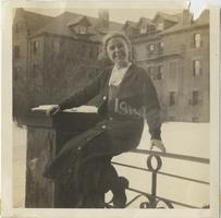 Frances Carrington, Class of 1915, posing on campus in front of a dormitory