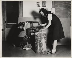 Burr Grumman and Beverly Jeffrey use a chisel to work on a Geology assignment, ca. 1946