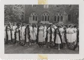 1961 class members lining up before laurel parade carrying laurel chain, 1961