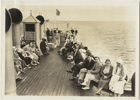 Travelers on deck of a ship during Marion Blake's Scandinavian trip, front and back of a picture