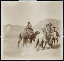 Mongols riding horses and camels, as seen by Viette Brown Sprague '71 during her time as a missionary in China, when she traveled to Mongolia