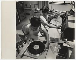 Two students working in the WMHC radio control room