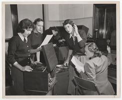 Five students, including Phoebe Hopkins '54, Marianne Lowenfield '52, and Narcissa Hargroves '53, using equipment in the WMHC radio station