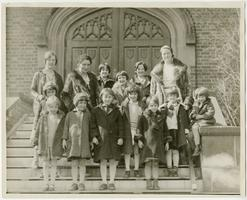 Virginia M. Hunt (far left), Class of 1934, and two other Mount Holyoke students with a group of children from a settlement house in Holyoke, Mass., on a visit to the campus sponsored by the Social Service Committee of the college Y.W.C.A.