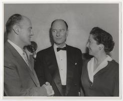 Sir John Gielgud, sponsored by the Dramatic Club to give a presentation of Shakespeare, speaking with President and Mrs. Richard Glenn Gettell