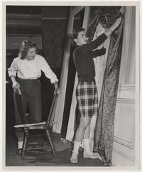 Allison Bigelow '59 and Miriam Deinard '59 working on set construction for a Dramatic Club play