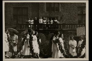 Graduating seniors in the Class of 1949 passing Clapp Laboratory as they march in the Laurel Parade