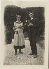 Marion Blake standing in a garden with an unidentified male companion