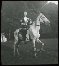 Lantern slide of Don Quixote on horseback for Romance Language skit for May Day Pageant