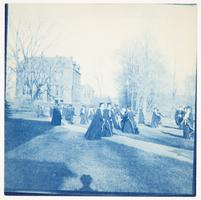 Graduates of the Class of 1900 participating in Senior Rope Jumping in front of Williston Hall