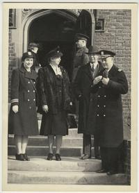 First Lady Eleanor Roosevelt during her visit to the Naval Training School at Mount Holyoke, flanked by (l-r) Lt. Cmdr. McAfee, President Roswell G. Ham, and Capt. Underwood