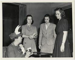 First Lady Eleanor Roosevelt speaking with three students during a visit to Mount Holyoke