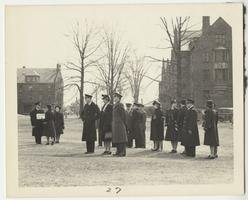 First Lady Eleanor Roosevelt and members of the Naval Training School gathered on Skinner Green, with Mead and Rockefeller Halls in the background