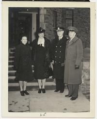 First Lady Eleanor Roosevelt standing with members of the Naval Training School outside Rockefeller Hall