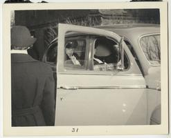 First Lady Eleanor Roosevelt shown in a car on her visit to the Naval Training School at Mount Holyoke