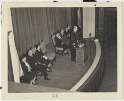 First Lady Eleanor Roosevelt during her visit to the Naval Training School at Mount Holyoke, seated with other dignitaries on the stage in Chapin Auditorium