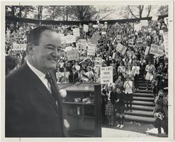 Vice-Presidential candidate, Senator Hubert Humphrey, standing before a tumultuous gathering of students and townspeople in Gettell Amphitheater