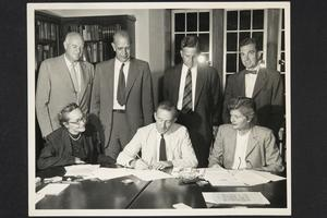 President Roswell Gray Ham and other local college presidents and librarians witnessing signing of application for incorporation of Hampshire Inter-Library Center