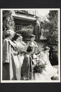 President Roswell Gray Ham viewing May Day festivities, including May Queen Jane McGonagle '56 and her court