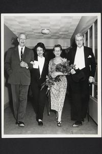 President and Mrs. Roswell Gray Ham being escorted by Professors Constance Meadnis Saintonge '28 and Denis Johnston