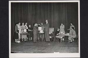 "President Roswell Gray Ham and others in a skit, ""Dollars and Sense at Mount Holyoke"""