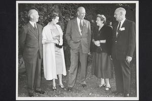 Group including President Roswell Gray Ham (center) and Mary Budd Dunn '29 and her husband (left)