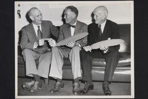 Massachusetts Governor Christian Herter (center), speaking with President Roswell Gray Ham (left)