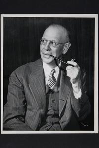 President Roswell Gray Ham with pipe in hand