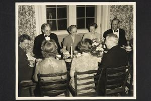 President and Mrs. Roswell Gray Ham and guests, including some Trustees, at a formal dinner