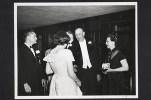 President and Mrs. Roswell Gray Ham in reception line at a prom