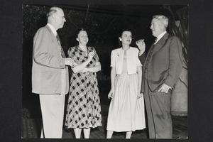 President Roswell Gray Ham (left) entertaining at a reception at the President's House during the Mount Holyoke Institute on the United Nations