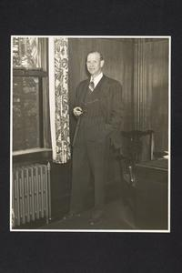 President Roswell Gray Ham standing near his desk