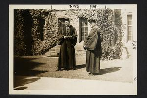 President Roswell Gray Ham (left) and Professor David Adams in academic robes