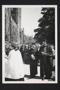 President Roswell Gray Ham on right, following choir in procession outside Abbey Memorial Chapel