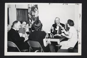 Group around a table, including l-r, Mr. Hall, Gertrude Bruyn '14, and President and Mrs. Roswell Gray Ham