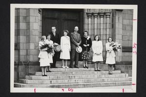 President and Mrs. Roswell Gray Ham and others standing on the steps of Abbey Memorial Chapel, possibly during Commencement Weekend