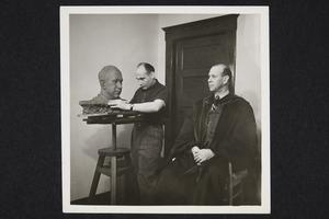 President Roswell Gray Ham sitting for a portrait bust being sculpted by Henry Rox, of the art department