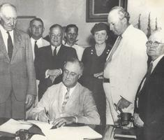 President Franklin D. Roosevelt Signs The Social Security Bill, August 14, 1935