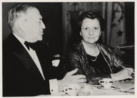 Frances Perkins and dinner companion, ca. 1938