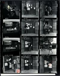 Photographic film contact sheet showing signs on library doors as part of Mount Holyoke students' participation in nationwide students' strike against the Vietnam War